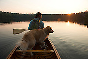 Sunrise canoe paddle on Grout Pond in the Green Mountain National Forest in Stratton, Vermont.