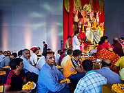 "23 SEPTEMBER 2018 - BANGKOK, THAILAND:  People pray during the Ganesha Festival at Wat Dan in Bangkok. Ganesha Chaturthi also known as Vinayaka Chaturthi, is the Hindu festival celebrated on the day of the re-birth of Lord Ganesha, the son of Shiva and Parvati. The festival, also known as Ganeshotsav (""festival of Ganesha"") is observed in the Hindu calendar month of Bhaadrapada, starting on the the fourth day of the waxing moon. The festival lasts for 10 days, ending on the fourteenth day of the waxing moon. Outside India, it is celebrated widely in Nepal and by Hindus in the United States, Canada, Mauritius, Singapore, Thailand, Cambodia, and Burma.    PHOTO BY JACK KURTZ"