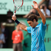 05 June 2007: Swiss player Roger Federer celebrates during the French Tennis Open quarter final match won 7-5, 1-6, 6-1, 6-2 by Roger Federer over Tommy Robredo on day 10 at Roland Garros, in Paris, France.