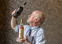 Auction house, Bonham's, will be holding a sale of rare whisky on 7 March 2018 at 11am. <br /> <br /> The sale includes two rare whiskies; a bottle of the Macallan Select Reserve 52 year-old 1946, bottled in May 1998. It is estimated at £12,000-14,000 and a bottle of Black Bowmore 1964, bottled in 1994, and estimated at £8,000-10,000. <br /> <br /> The 1946 Macallan was produced in an unusual way. Coal was scarce and expensive immediate after World War II, so the malt was dried in peat-fired kilns instead resulting in a whisky with distinct and complex tastes and aromas.<br /> <br /> Pictured: Danny McIlwraith of Bonham's with the Macallan 1946 and the Black Bowmore 1964
