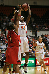 Tiffany Sardin (33) attempts a shot over a Wolfpack defender.  UVA fell to NC State 73-63 in ACC action at U-hall.