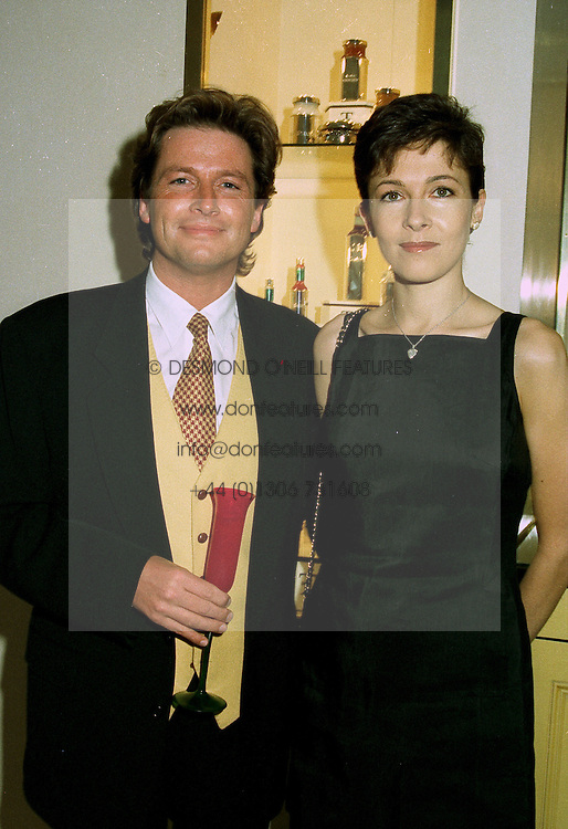 MR KEVIN BALL and MISS DEBBIE MOORE daughter of actor Roger Moore at a party in London on 1st July 1997.LZX 7