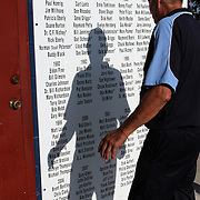 Merle Eberly stops to look at the list of Clarinda A's Hall of Fame members located on west wall of concession stand/clubhouse at Municipal Stadium in Clarinda.  photo by David Peterson
