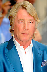 Bula Quo UK film premiere.  <br /> Rick Parfitt, attends premiere of Status Quo action film featuring 12 of the rock band's classic tracks. Directed by former stunt co-ordinator Stuart St Paul, starring Jon Lovitz, Craig Fairbrass, Laura Aikman and the band members themselves. Released July 5. Odeon West End, London, United Kingdom.<br /> Monday, 1st July 2013<br /> Picture by Chris Joseph / i-Images