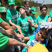 The Greenwich team prepare for the game with a group cheer during the Norwalk Little League baseball 'Champions' team V Greenwich in the Challenger Division  Recognition Day competition. The day acknowledged the many talents of the great players on the Challenger Division teams. The division has weekly games and practices for kids with special needs. Challenger division are held throughout the country.  Broad River Fields, Norwalk, Connecticut. USA. 2nd June 2013. Photo Tim Clayton