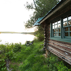 A cabin on the shore of Long Pond at the Appalachian Mountain Club's Gorman Chairback Lodge. Near Greenville, Maine.