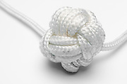Turk's head knot on white background used traditionally to through a rope from vessel to vessel or to shore