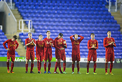 READING, ENGLAND - Wednesday, March 12, 2014: Liverpool's players look on as they lose 5-4 on penalties after a 4-4 draw against Reading during the FA Youth Cup Quarter-Final match at the Madejski Stadium. Harry Wilson, Jordan Rossiter, Daniel Trickett-Smith, Daniel Cleary, Jordan Williams, Sergi Canos, Joe Maguire, Lloyd Jones. (Pic by David Rawcliffe/Propaganda)