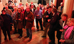 © under license to London News Pictures.  13/12/2010..Parishioners gather to bid at the age-old tradition of a candle auction. The auction held every three years, is where people bid to lease a local meadow while a candle containing a horse-nail burns...The person with the bid when the nail drops out of the specially-made tallow candle is declared the winner...The event, which originates from the early 1800s, was held at Aldermaston Parish Hall, Berkshire, with the local vicar as the auctioneer. Church wardens, in-keeping with tradition, are given pipes, although they were not allowed to light them...Picture credit should read: Rebecca Mckevitt/London News Pictures