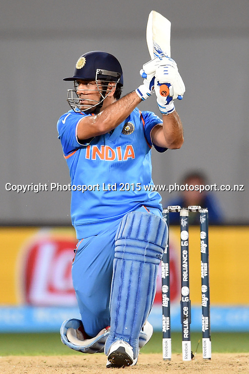 Indian batsman Mahendra Singh Dhoni in action during the ICC Cricket World Cup match between India and Zimbabwe at Eden Park in Auckland, New Zealand. Saturday 14 March 2015. Copyright Photo: Raghavan Venugopal / www.photosport.co.nz