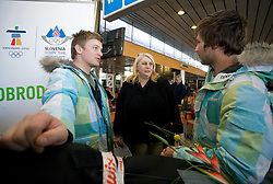 Slovenian alpine skier Andrej Krizaj and cross skier Filip Flisar (R) and Filip's mother at arrival to Airport Joze Pucnik from Vancouver after Winter Olympic games 2010, on February 25, 2010 in Brnik, Slovenia. (Photo by Vid Ponikvar / Sportida)