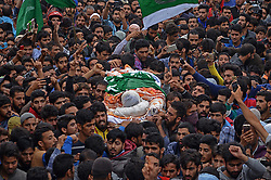 August 14, 2017 - Chadoora , Kashmir, India - People carry the dead body of chief operational commander of Hizbul Mujahideen militant outfit YASIN ITOO alias Mehmood Gaznavi in Chadoora some 30 kilometers from Srinagar the summer capital of Indian controlled Kashmir. Yasin the longest surviving militant and active from 1997 in Kashmir took the command of Hizbul Mujahideen after the death of its commander Burhan Muzafar Wani in July 2016. Three militants, two army soldiers and two civilians were killed in an 18-hour-long gunfight between government forces and militants in Awneera village of south Kashmir's Shopian district on Sunday. (Credit Image: © Faisal Khan/Pacific Press via ZUMA Wire)