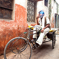Indian Man Smoking On His Retro Cargo Bicycle in Jaipur, Rajasthan, India