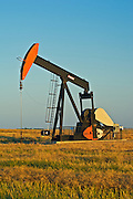 oil pump jack and canola field<br /> Carlyle<br /> Saskatchewan<br /> Canada