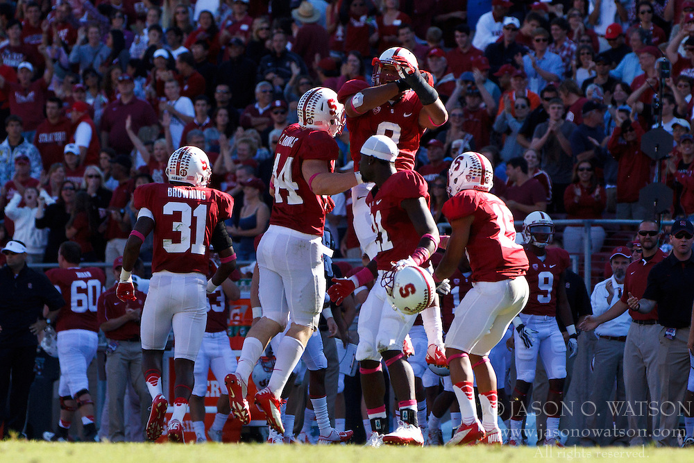 PALO ALTO, CA - OCTOBER 06: The Stanford Cardinal celebrate after intercepting a pass against the Arizona Wildcats during overtime at Stanford Stadium on October 6, 2012 in Palo Alto, California. The Stanford Cardinal defeated the Arizona Wildcats 54-48 in overtime. (Photo by Jason O. Watson/Getty Images) *** Local Caption ***