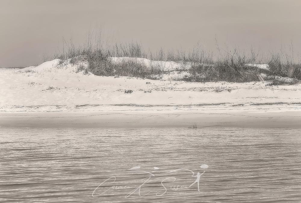 Waves ripple alongside a beach, Mary 6, 2016, in Dauphin Island, Alabama. (Photo by Carmen K. Sisson/Cloudybright)