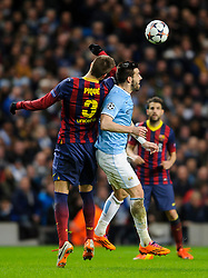 Man City Forward Alvaro Negredo (ESP) and Barcelona Defender Gerard Pique (ESP) compete in the air - Photo mandatory by-line: Rogan Thomson/JMP - Tel: 07966 386802 - 18/02/2014 - SPORT - FOOTBALL - Etihad Stadium, Manchester - Manchester City v Barcelona - UEFA Champions League, Round of 16, First leg.