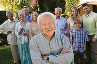 Senior man celebrating with friends in garden