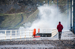 © London News Pictures. 04/01/2018. Aberystwyth, UK.  On the day after Storm Eleanor swept a trail of damage across the UK, strong westerly winds gusting over 75 mph whip the high Spring Tide into huge waves that batter the seafront at Aberystwyth on the Cardigan Bay coast of west Wales. Photo credit: Keith Morris/LNP