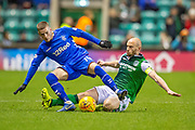 David Gray (#2) of Hibernian FC slide tackles Ryan Kent (#14) of Rangers FC during the Ladbrokes Scottish Premiership match between Hibernian and Rangers at Easter Road, Edinburgh, Scotland on 8 March 2019.