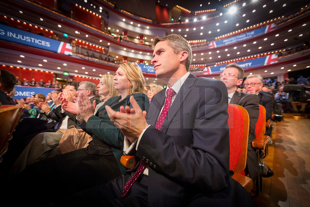 © Licensed to London News Pictures. 03/10/2018. Birmingham, UK. Gavin Williamson watches the Prime Minister Theresa May gives her speech to her party on the final day of the Conservative Party Conference being held at the International Convention Centre in Birmingham. Photo credit: Andrew McCaren/LNP