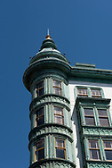 """""""Coppola's Cupola,"""" the landmark Beaux-Arts flatiron building in North Beach with weathered copper trim. It's also known as the Sentinel Building and Columbus Tower. The building is owned by Francisc Ford Coppola whose Cafe Zoetrope restaurant is in the street level."""
