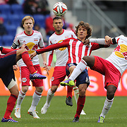 Carlos Alvarez, (left) and Agustin Pelletieri, (centre), Chivas USA, challenge Peguy Luyindula, New York Red Bulls, for the ball during the New York Red Bulls V Chivas USA, Major League Soccer regular season match at Red Bull Arena, Harrison, New Jersey. USA. 30th March 2014. Photo Tim Clayton