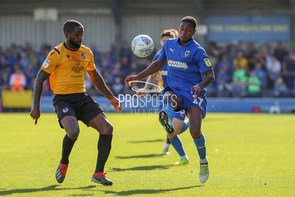 AFC Wimbledon attacker Michael Folivi (17) battles for possession with Bristol Rovers midfielder Abu Ogogo (4) during the EFL Sky Bet League 1 match between AFC Wimbledon and Bristol Rovers at the Cherry Red Records Stadium, Kingston, England on 21 September 2019.