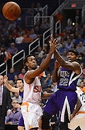 Nov 20, 2013; Phoenix, AZ, USA; Sacramento Kings guard Isaiah Thomas (22) makes a pass against the Phoenix Suns guard Ish Smith (3) in the first half at US Airways Center. The Kings defeated the Suns 113-106. Mandatory Credit: Jennifer Stewart-USA TODAY Sports