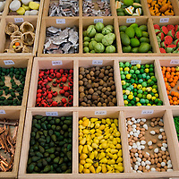 Miniatures of food and tools for nativity scenes for sale in a wooden display case at a market near the cathedral, Seville, Andalusia, Spain, Europe.