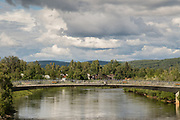 View of the Chena River from the Cushman Street bridge showing Griffin downtown riverfront park in Fairbanks, Alaska.