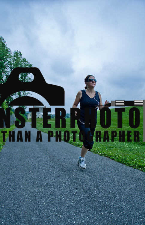 07/08/11 Hockessin DE: Traci Murphy (37) running on the trails of Tweed's Park Friday, July 8, 2011, in Hockessin Delaware...Special to The News Journal/SAQUAN STIMPSON