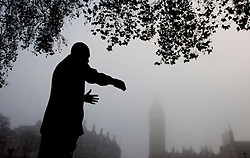 © Licensed to London News Pictures.11/12/2013. London, UK.The statue of Nelson Mandela is seen in fog this morning.Photo credit : Peter Kollanyi/LNP