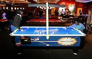 Amanda James, 17, and Jay James, 7, of Spring Valley play air hockey at Lucky Strike Lanes at the Palisades Center mall in West Nyack on Jan. 12, 2007.