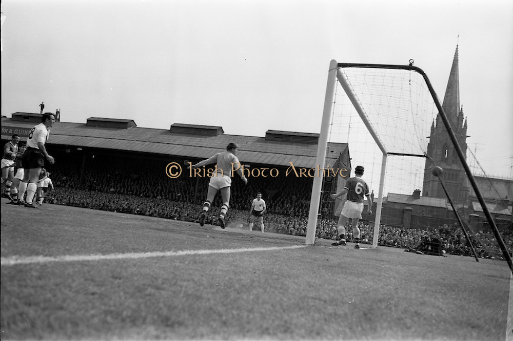 24/05/1964<br /> 05/24/1964<br /> 24 May 1964<br /> Soccer International: Ireland v England at Dalymount Park, Dublin. England won the game 3-1.  Englands second goal from George Eastham, (not in picture) beats Irish goalie Noel Dwyer (centre). Also in the picture are Mick McGrath (6 Ireland); and English inside right Jimmy Greaves (8).