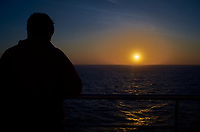 Silhouette of a student watching the sun set over the Atlantic Ocean from the deck of the MV Explorer. Image taken with a Leica X2 camera.