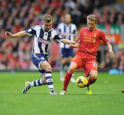 West Bromwich Albion's James Morrison batlles for the ball with Liverpool's Lucas Leiva- Photo mandatory by-line: Alex James/JMP - Tel: Mobile: 07966 386802 26/10/2013 - SPORT - FOOTBALL - Anfield Stadium - Liverpool - Liverpool v West Brom - Barclays Premier League