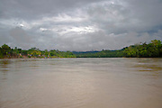 """View of Mara-on river in Amazons district, Peru. After the events of June 5 in the Amazonian province of Bagua, in northeastern Peru, where 24 policemen and a number still not confirmed of natives from the communities of the ÒAlto Mara-onÓ and civilians died in clashes after a series of demonstrations in opposition to the approval by the Peruvian government, for a group of ordinances that allow large flexibility in the restrictions on resource extraction in the area, breaking the 169 agreement of ILO (International Labour Organization), which requires the consultation of indigenous communities about the exploitation of nature in their territories. One of the most active communities was the awajun, a warlike and revengeful people, heritors of the Jibaros and recently contacted near to 1950. For the leader or """"apu"""" for one of the aguarunas riverside communities of the Mara-on, Simon Weepiu, Òthe force of this movement come from the conviction of the struggle, which is caused by the ancestral development as based on worldview, which provides the native of a special power, that of becoming one with his idea and his brothers, to focus all on the same objective and be just a great strength."""" The government aims to generate development in the area allowing the exploitation of property, The jungle is rich in gold and oil, and even argue that natural wealth of the region belong to all Peruvians, and not just the communities that inhabit it, but acts as the oil«s filtration to waters of the Mara-on, left in evidence that in a complex ecosystem like jungle that mixed spilled oil by rain in the river, home to fishes, as well as the waters that irrigate cassava, bananas, sugarcane and other elements vital to the development of communities. The natives, insist that the forest is not only home, is where they get medicines to cure their sick and food for their families. The pre-existence and natural wisdom places them in a privileged place in defining or participate today in the de"""