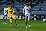 AFC Wimbledon midfielder Dean Parrett (18) shoots at goal during the EFL Sky Bet League 1 match between Coventry City and AFC Wimbledon at the Ricoh Arena, Coventry, England on 28 September 2016. Photo by Stuart Butcher.