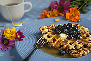 Waffles, Blueberries, and Tea by Rodney Bedsole, a food photographer based in Nashville and New York City.
