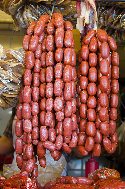 Strings of chorizo sausages hand at a butcher shop in Oaxaca, Mexico.