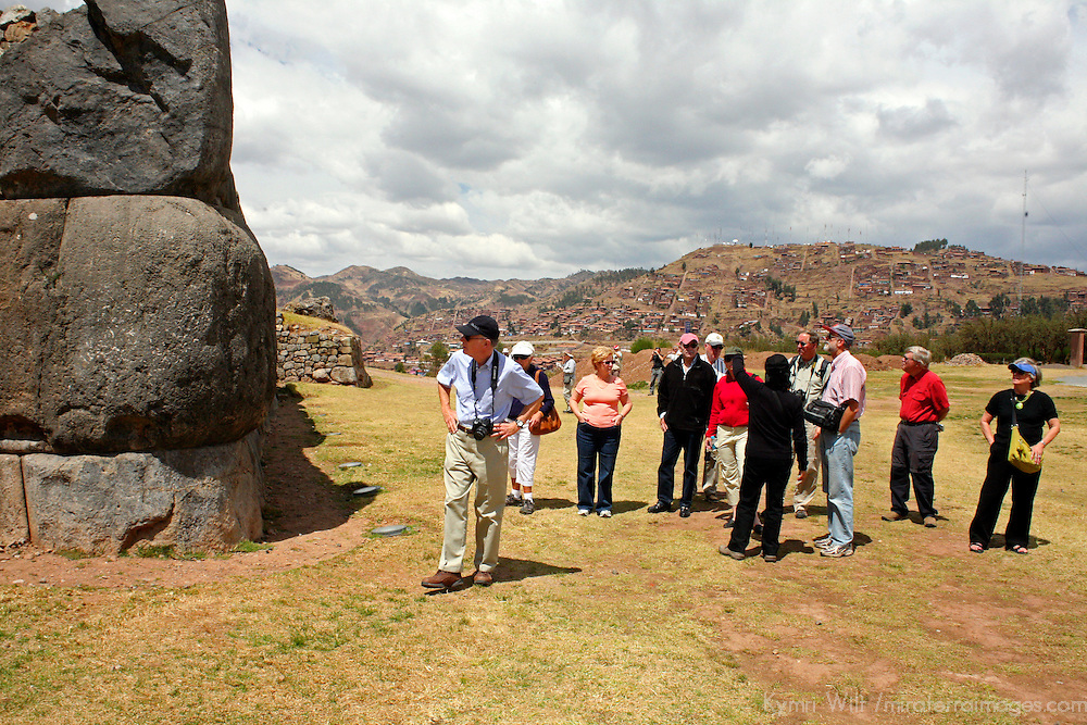 South America, Peru, Cusco. Tour group visiting the fortress of Sacsayhuaman, on the outskirts of Cusco in the Andes.