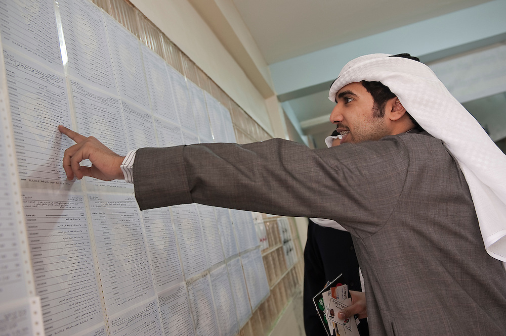 Kuwaiti voter points to his name at a polling station in Kuwait City ahead of voting in the February 2 parliamentary elections. A total of 400,296 Kuwaiti men and women are eligible to vote to choose from among some 285 candidates, including more than 20 women candidates, for a new 50-seat parliament.