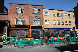 © Licensed to London News Pictures. 14/05/2019. London, UK. General view of the scene on Great Peter Street where a fire around a building site caused damage to buildings and the surrounding area. Photo credit : Tom Nicholson/LNP
