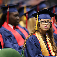 Hannah Hester looks inot the stands for freinds and family at her graduation on Saturday.