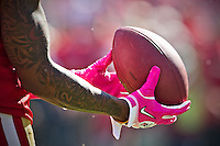30 October 2011: Wide receiver (19) Ted Ginn, Jr. of the San Francisco 49ers warms up catching the football with pink Breast Cancer Awareness gloves before the 49ers 20-10 victory against the Cleveland Browns in an NFL football game at Candlestick Park in San Francisco, CA.