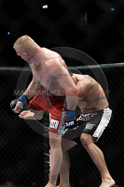 "MANCHESTER, ENGLAND, NOVEMBER 14, 2009: Dennis Siver (near) connects with a spinning back kick to Paul Kelly during ""UFC 105: Couture vs. Vera"" inside the MEN Arena in Manchester, United Kingdom."