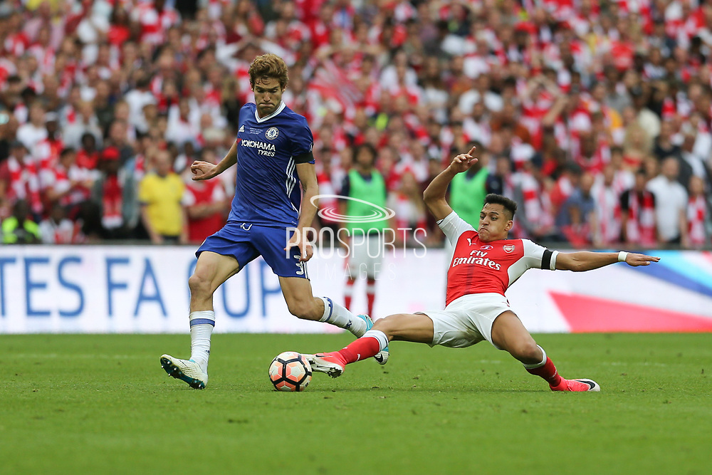 Chelsea's Marcos Alonso(3) is tackled by Arsenal's Alexis Sánchez(7) during the The FA Cup final match between Arsenal and Chelsea at Wembley Stadium, London, England on 27 May 2017. Photo by Shane Healey.