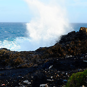 Waves crashes again rocks near the Duck Pond in Charco del Palo, Lanzarote.