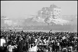 Yasser Arafat's body is flown into Ramallah on Egyptian helicopters after a large service memorial service attended by world leaders in Cairo. Thousands of Palestinians came out to take part in the burial service in the al-Muqataa compound in Ramallah.